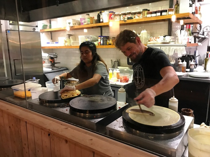 Julien and Employee Making Crepes at Whisk Crepe Cafe